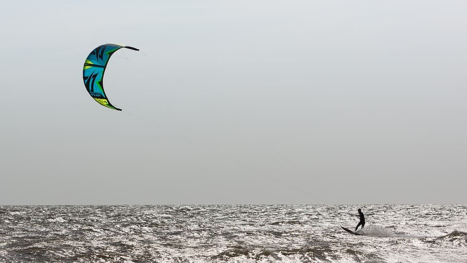 kiteboarding sailing cross over